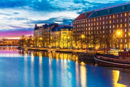 Scenic evening panorama of sea pier illuminated architecture in Hakaniemi district in Helsinki, Finland