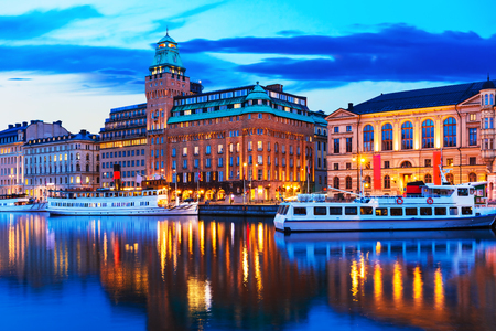 Scenic summer evening panorama of the Old Town  Gamla Stan  architecture pier in Stockholm, Sweden photo