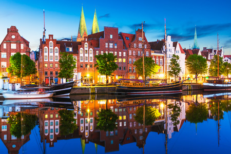 Scenic summer evening view of the Old Town pier architecture in Lubeck, Germany photo