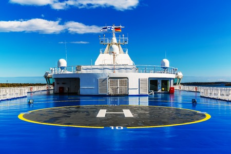 helicopter pad: Helipad for helicopter on the upper deck of big cruise ship