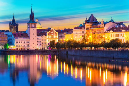 Scenic summer sunset panorama of the Old Town ancient architecture and Vltava river pier in Prague, Czech Republic photo