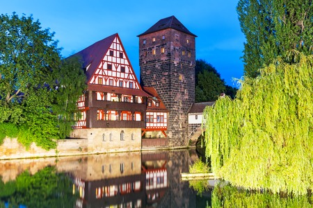 half timbered house: Scenic summer night view of the Old Town pier architecture in Nuremberg, Germany Stock Photo