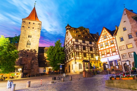 Scenic summer night view of the Old Town medieval architecture with half-timbered buildings in Nuremberg, Germany 스톡 콘텐츠