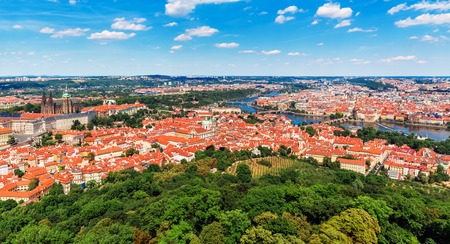 Scenic summer aerial panorama of the Old Town architecture in Prague, Czech Republic with Saint Vitus Cathedral, Vltava River and Charles Bridge photo