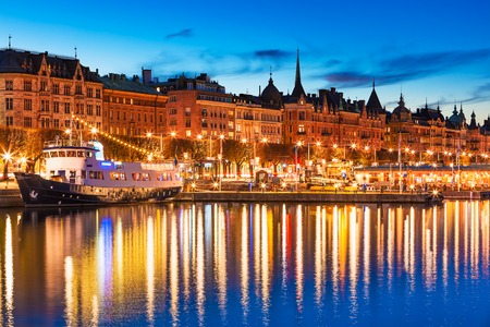 Scenic summer evening panorama of the Old Town (Gamla Stan) architecture pier in Stockholm, Sweden photo