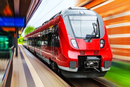 blur subway: Railroad travel and railway tourism transportation industrial concept: scenic summer view of modern high speed passenger commuter train on tracks at the station platform with motion blur effect
