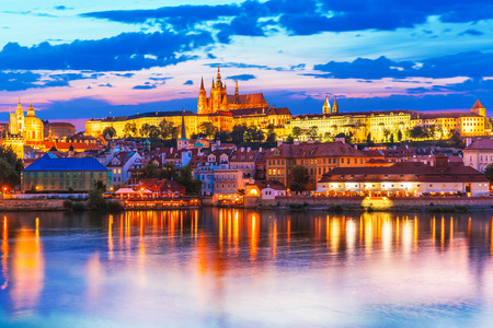 prague: Scenic summer evening panorama of the Old Town architecture with Vltava river and St.Vitus Cathedral in Prague, Czech Republic