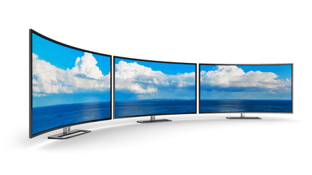 Creative abstract television electronics technology business concept: panoramic group of modern curved TV display screens or computer PC monitors isolated on white background