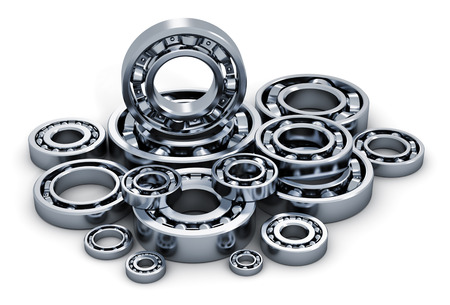 Creative abstract industry, manufacturing and engineering concept: collection of different steel shiny ball bearings isolated on white background Archivio Fotografico