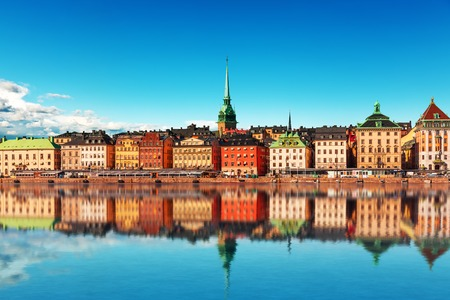 scenic: Scenic summer panorama of the Old Town (Gamla Stan) pier architecture in Stockholm, Sweden