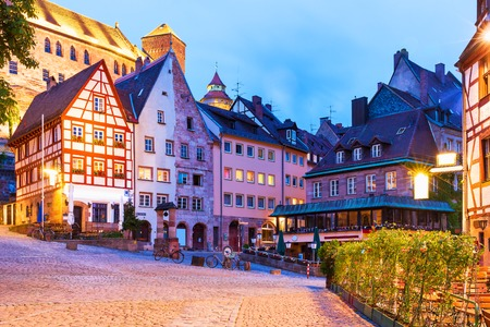 bayern old town: Scenic summer night view of the Old Town medieval architecture with half-timbered buildings in Nuremberg, Germany Stock Photo