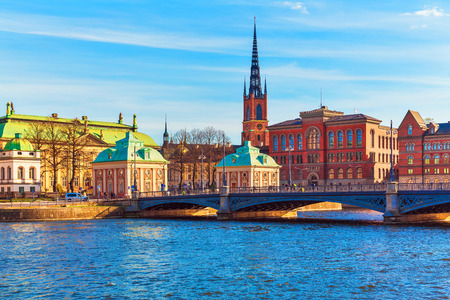 Scenic summer panorama of the Old Town (Gamla Stan) architecture pier in Stockholm, Sweden photo