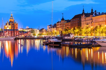 Scenic summer evening panorama of the Old Port pier architecture with tall historical sailing ships, yachts and boats and Uspenski Orthodox Cathedral in the Old Town in Helsinki, Finland Standard-Bild
