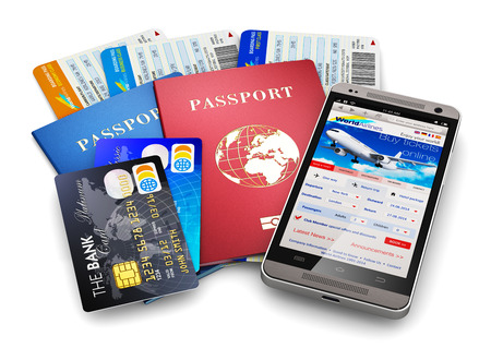 Creative abstract business travel and tourism concept: air tickets or boarding pass, passports, touchscreen smartphone with online airline tickets booking or reservation internet application and credit cards isolated on white background photo