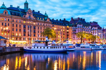 Scenic summer evening panorama of the Old Town (Gamla Stan) architecture pier in Stockholm, Sweden