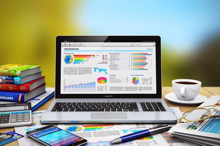 Creative abstract mobile business work, internet web communication and financial development, banking, commercial accounting, growth and success technology concept: modern laptop or notebook, touchscreen smartphone, newspaper, calculator, credit cards, ba Banque d'images