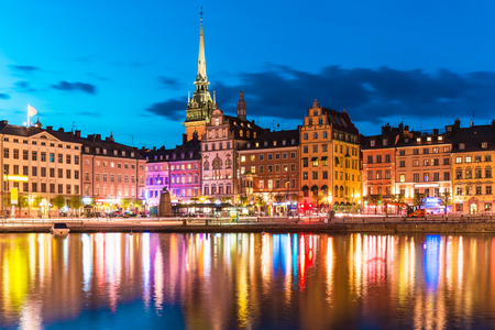Scenic summer night panorama of the Old Town (Gamla Stan) architecture pier in Stockholm, Sweden photo