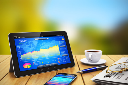 Creative abstract mobile business internet communication banking and wireless office computer web work and financial accounting success concept: modern black glossy tablet PC with colorful touchscreen interface of stock exchange market application, newspa photo
