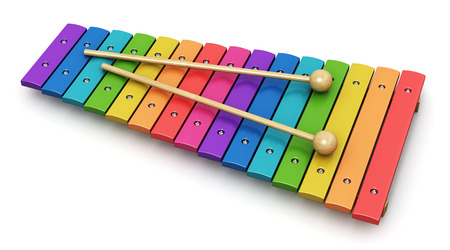 Creative abstract percussion musical instrument and music art creation concept: colorful rainbow wooden xylophone with two wood drum sticks isolated on white background photo