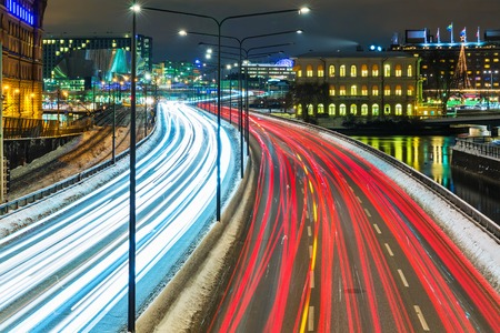 night traffic: Night scenery of the Old Town (Gamla Stan) pier architecture with highway road transportation traffic in Stockholm, Sweden