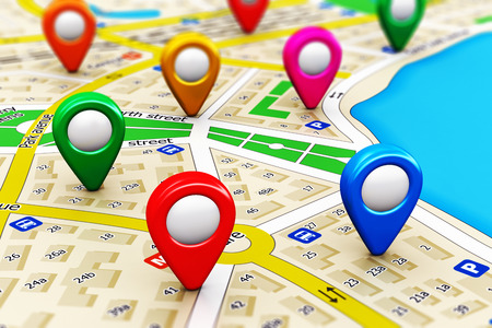 Creative abstract GPS satellite navigation, travel, tourism and location route planning business concept: macro view of color city map with group of colorful destination pointer marker icons with selective focus effect