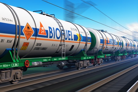 Creative abstract fuel, oil and gas industry, ecology protection technology, logistics, cargo shipping and freight railroad transportation business concept: fast train with tankcars with biofuel with motion blur effect