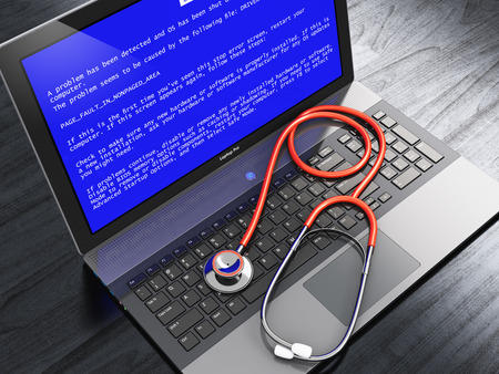 Creative abstract computer antivirus protection technology and repair maintenance service business concept: modern laptop or notebook computer PC with blue screen with critical error message and stethoscope on black wooden business office table