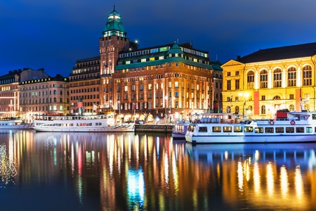 gamla stan: Scenic summer night panorama of the Old Town (Gamla Stan) architecture pier in Stockholm, Sweden