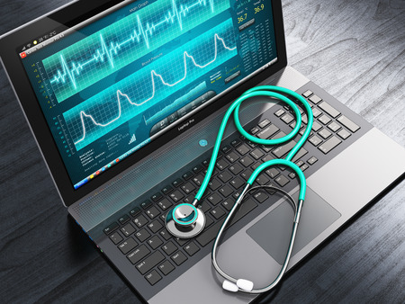 display screen: Creative abstract healthcare, medicine and cardiology tool concept: laptop or notebook computer PC with medical cardiologic diagnostic test software on screen and stethoscope on black wooden business office table Stock Photo