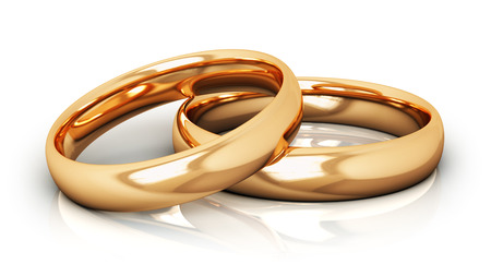 Creative abstract love, engagement, proposal and matrimony concept: macro view of pair of shiny golden wedding rings isolated on white background with reflection effect