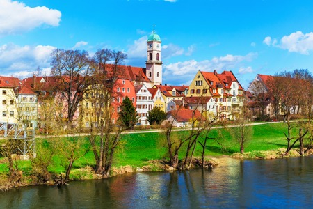 bayern old town: Scenic spring view of old buildings at Danube river pier and street architecture in the Old Town of Regensburg, Bavaria, Germany