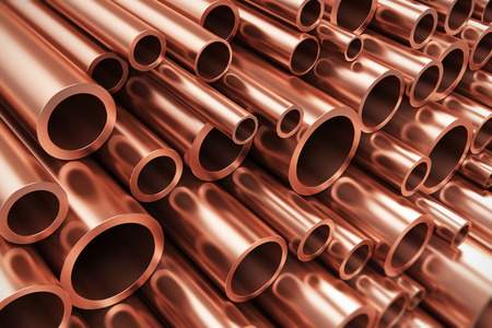 Creative abstract heavy non-ferrous metallurgical industry and industrial manufacturing business production concept: heap of shiny metal copper pipes with selective focus effect Stockfoto