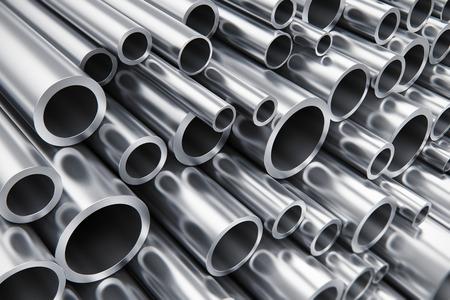 metales: Pesada industria creativa abstracta metalúrgico y de fabricación industrial concepto de producción de negocios: Montón de tubos de acero de metal brillante con efecto de enfoque selectivo