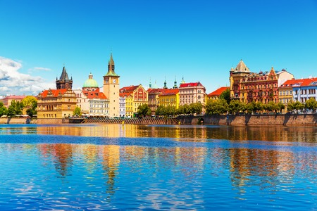 the river: Scenic summer view of the Old Town ancient architecture and Vltava river pier in Prague Czech Republic