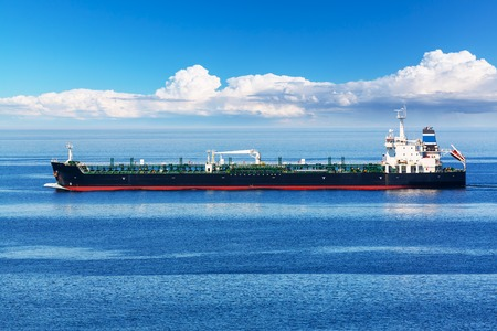 Creative absract old and gas industry and sea transportation, shipping and logistics business trading commerce concept: Industrial oil and chemical commercial tanker ship vessel in blue ocean Stock Photo