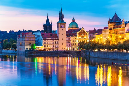 vltava: Scenic summer evening view of the Old Town ancient architecture and Vltava river pier in Prague, Czech Republic Stock Photo