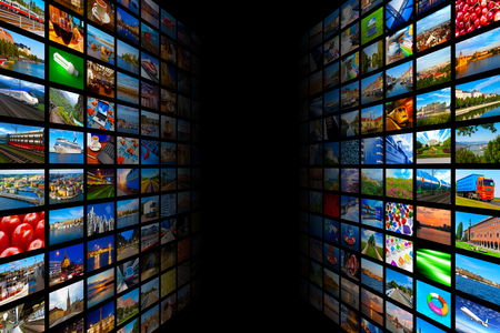 film: Creative abstract web streaming media TV video technology and multimedia business internet communication concept: black background with endless walls of screens with color photos and colorful displays with different images