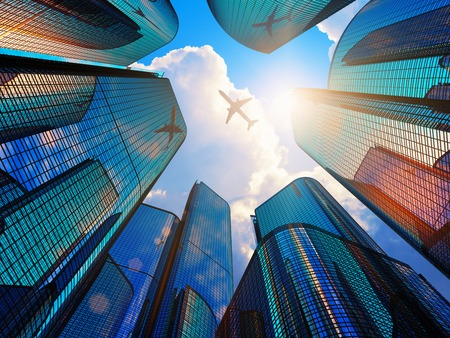 airplane: Creative abstract business corporate construction industry and real estate financial concept: blue modern high tall glass reflective skyscrapers in city downtown district with sun light and airliner