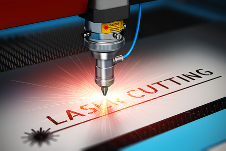 Laser cutting metal industry concept: macro view of industrial digital CNC - computer numerical control CO2 invisible laser beam cutter machine cutting stainless steel sheet with lot of bright shiny sparkles