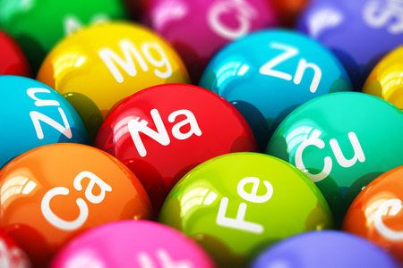 Creative abstract health lifestyle, diet and healthy eating and nutrition food concept: macro view of color balls, pills or tablets with minerals and microelements names with selective focus effect