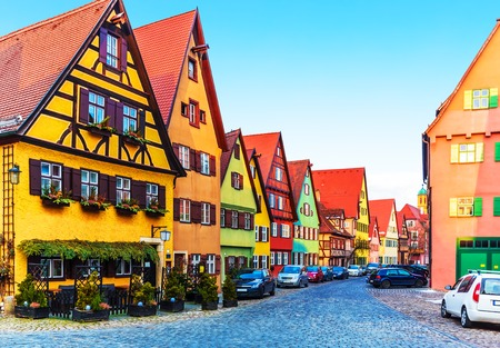 bayern old town: Scenic view of ancient medieval urban street architecture with half-timbered houses in the Old Town of Dinkelsbuhl, Bavaria, Germany