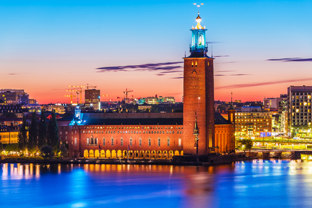 gamla stan: Scenic evening view of ancient City Hall palace and tower architecture building in the Old Town Gamla Stan of Stockholm, Sweden Stock Photo