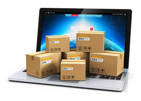 Creative abstract shipping, delivery and logistics technology business industrial concept: heap of stacked corrugated cardboard package boxes on computer PC laptop notebook keyboard isolated on white background