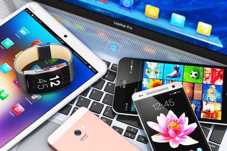 Creative abstract mobility and modern internet business communication technology web concept: 3D render illustration of macro view of modern mobile devices - black glossy touchscreen smartphone or mobile phone, tablet computer PC, laptop or notebook and s