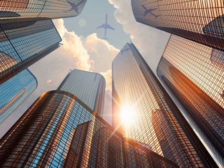 Creative abstract business corporate construction industry and real estate financial concept: 3D render illustration of beautiful sunset with blue modern high tall glass reflective skyscrapers in city downtown district with sun light and airliner in drama