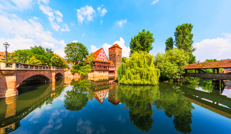 Scenic summer view of the German traditional medieval half-timbered Old Town architecture and bridge over Pegnitz river in Nuremberg, Germany