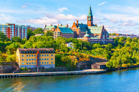 Scenic summer panorama of the Old Town pier architecture in Stockholm, Sweden