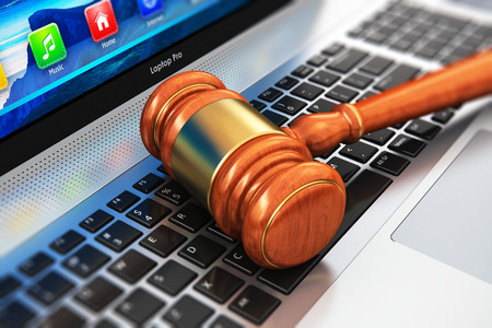 Creative abstract law, justice and auction lot bidding business concept: 3D render illustration of wooden gavel, mallet or hammer on notebook or laptop computer PC keyboard with selective focus effect Stock Photo