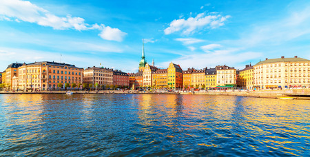 gamla stan: Scenic summer panorama of the Old Town (Gamla Stan) architecture pier in Stockholm, Sweden Stock Photo