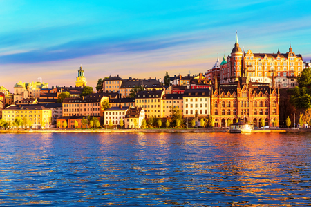 Scenic summer sunset view of the Old Town pier architecture in Sodermalm district of Stockholm, Sweden Stock Photo